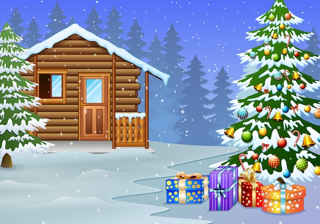 View of snowy wooden house and christmas tree decoration with the gift