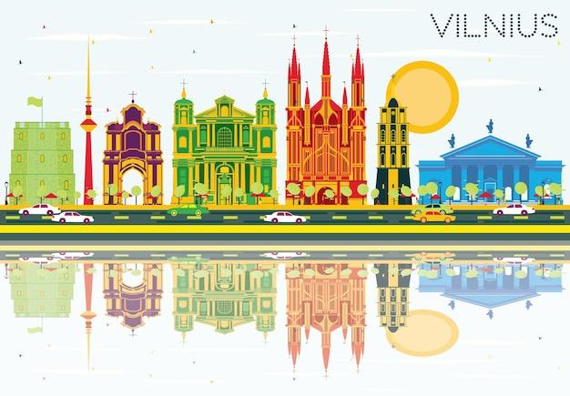Горизонт вильнюса с цветными зданиями, голубым небом и отражениями. векторные иллюстрации. деловые поездки и концепция туризма с исторической архитектурой. изображение для презентационного баннера и веб-сайта.