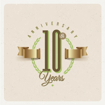 Vintage 10th years anniversary emblem with golden ribbon and laurel wreath - illustration