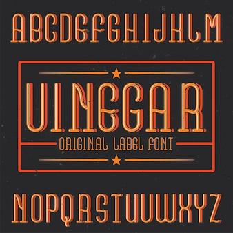Carattere tipografico vintage di alfabeto ed etichetta denominato aceto.