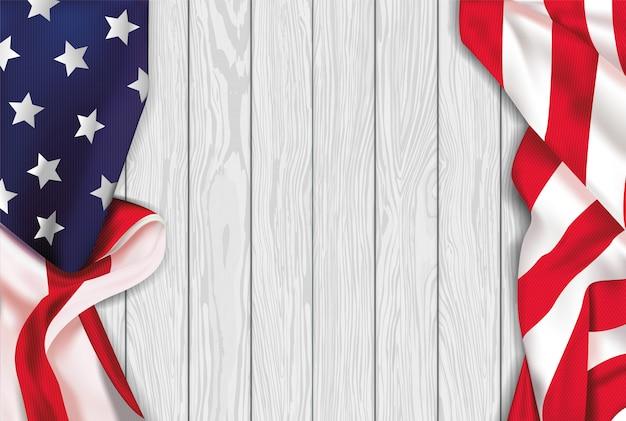 白い木製の背景にヴィンテージのアメリカの現実主義者の旗