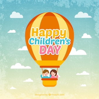 Vintage background with an hot air balloon and two kids