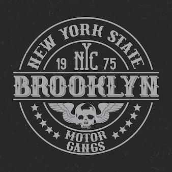 Vintage  badge with lettering composition on dark background.