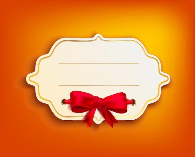 ゴールドフレームとオレンジ色の背景に赤の弓とビンテージバナー