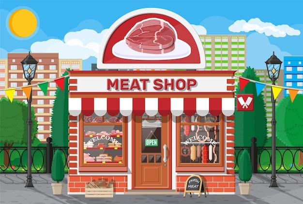 店先のあるヴィンテージ肉屋店のファサード。肉通りの市場。肉屋の屋台ショーケースカウンター。ソーセージスライスは、ビーフポークチキンのデリカテッセン美食製品です。