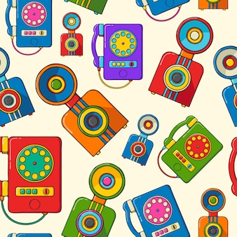 Vintage cameras and phones hand drawn pop art style seamless pattern.