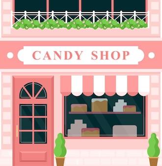 ヴィンテージキャンディーショップ、菓子屋。漫画のヨーロッパの街の通りの外観、正面玄関のドア