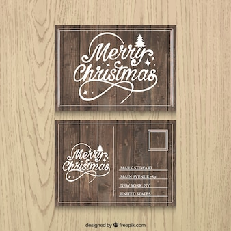 Vintage christmas postcard with wood texture Free Vector