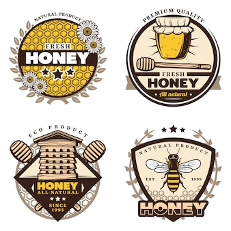 Vintage colored honey emblems set with letterings honeycombs flowers jar stick hive bee isolated