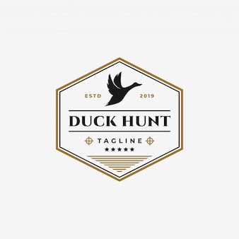 Vintage duck hunting club, flying goose, swan badge logo design template