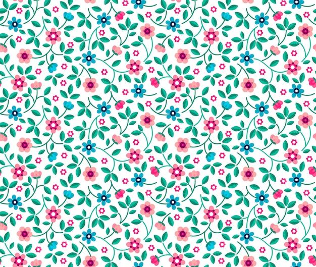 ヴィンテージの花の背景。デザインとファッションプリントのシームレスパターン。白地に小さな青とピンクの花と花柄。頭が変なスタイル。