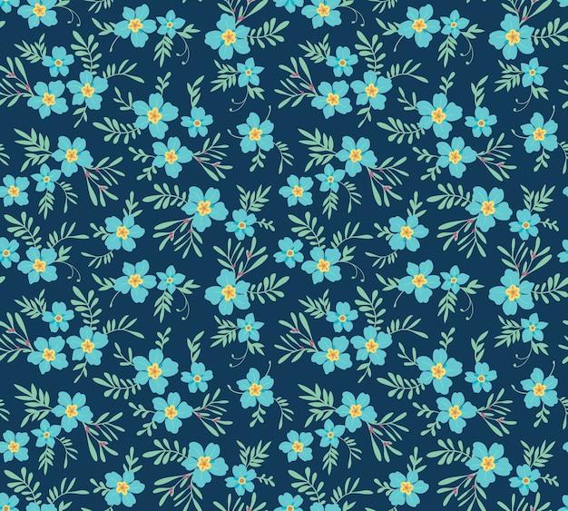 ヴィンテージの花の背景。デザインとファッションプリントのシームレスパターン。紺色の背景に小さな青い花と花柄。頭が変なスタイル。