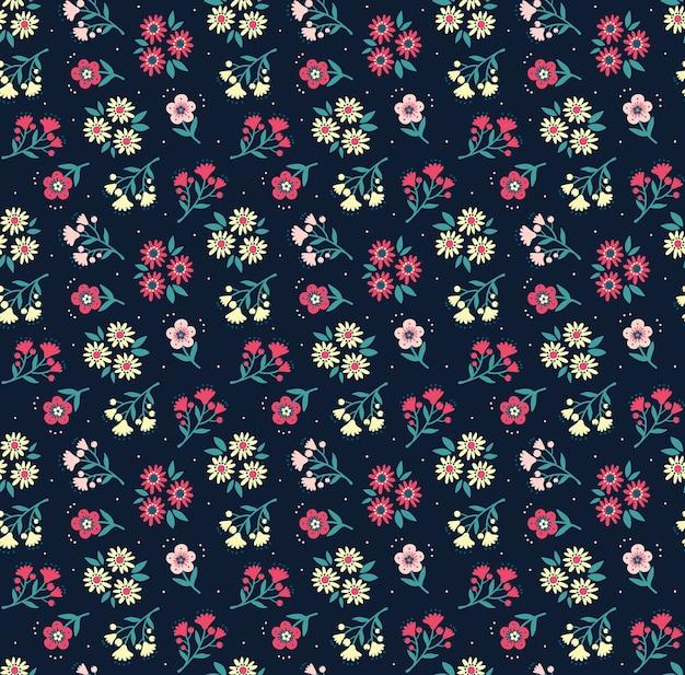 ヴィンテージの花の背景。デザインとファッションプリントのシームレスパターン。紺色の背景に小さなカラフルな花と花柄。頭が変なスタイル。
