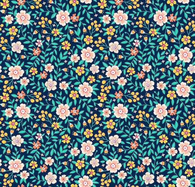 ヴィンテージの花の背景。デザインとファッションプリントのシームレスパターン。紺色の背景に小さな黄色い花と花柄。頭が変なスタイル。