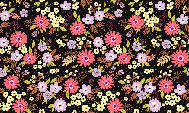 ヴィンテージの花の背景。黒の背景に小さな花とのシームレスなパターン。