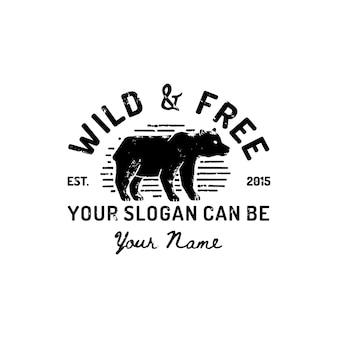 ヴィンテージハイイログマのロゴの手描き。野生アメリカのベクトルシンボル、クマのシルエット。ヴィンテージのタイポグラフィはワイルドで無料です。印刷物、ポスター、tシャツ、表紙、バナー、その他のビジネス用のテンプレート