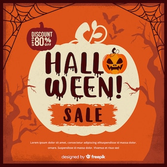 Vintage halloween sale with cobwebs and pumpkin