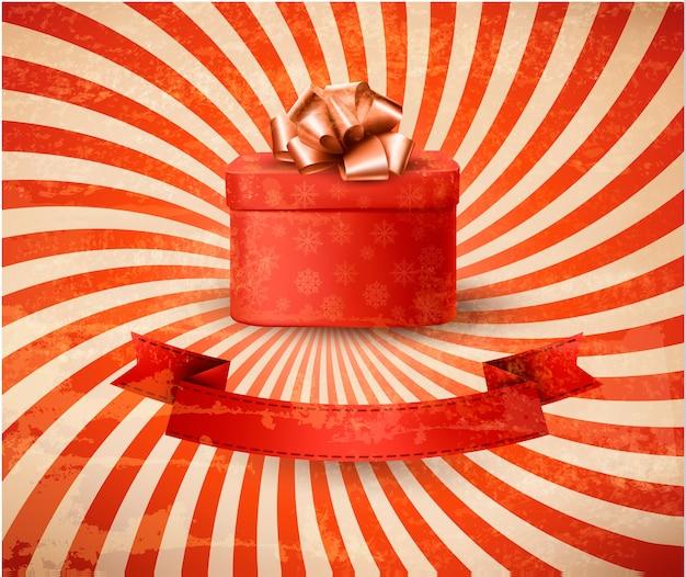 Старинный праздничный фон с красной подарочной коробкой