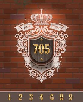 レンガの壁-イラストの塗られた紋章とビンテージホーム番号記号