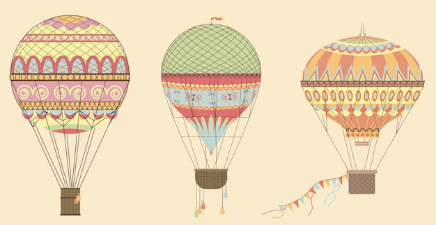 Vintage hot air balloons in sky.