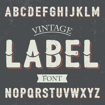 Poster di carattere etichetta vintage con alfabeto sull'illustrazione grigia