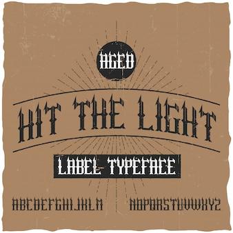 Hit the lightという名前のヴィンテージラベルタイプフェース。ヴィンテージのラベルやロゴに使用するのに適したフォント。