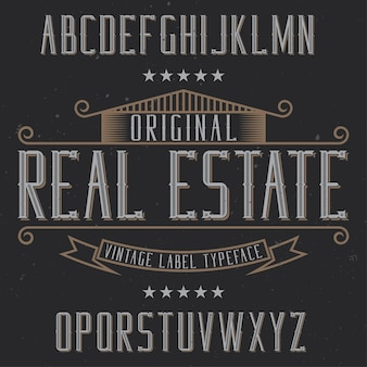 Старинный шрифт этикетки с именем real estate. хороший шрифт для любых винтажных этикеток или логотипов.