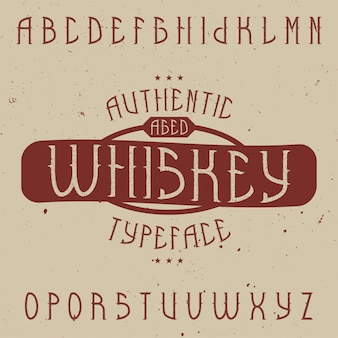 Винтажный шрифт этикетки с именем виски. хороший шрифт для любых винтажных этикеток или логотипов.