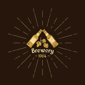 Vintage logo beer. brewery.  beer bottles, hops leaves and text on a brown background
