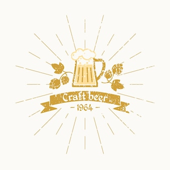 Vintage logo beer. brewery. beer mug, hops leaves and text in the ribbon, on white background