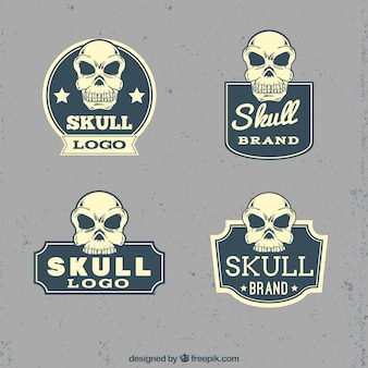 Vintage logos of decorative skulls