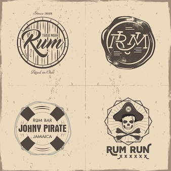 Vintage logos with rum barrel, pirate skeleton head, bones and text