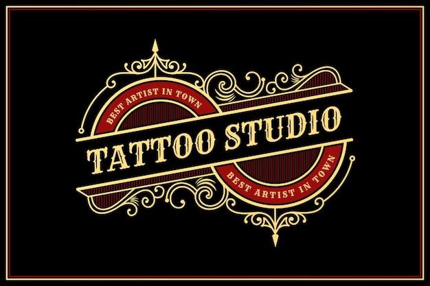 장식용 장식 프레임이 있는 빈티지 럭셔리 문신 스튜디오 레터링 로고