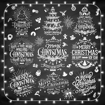 Vintage merry christmas and happy new year calligraphic and typographic background set with chalk word art on blackboard