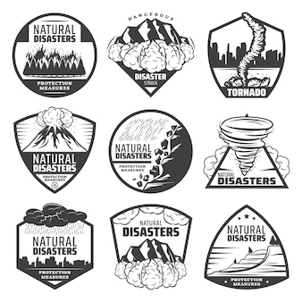 Vintage monochrome natural disaster labels set with wildfire landslide avalanche tornado volcano eruption thunderstorm rainfall flood isolated