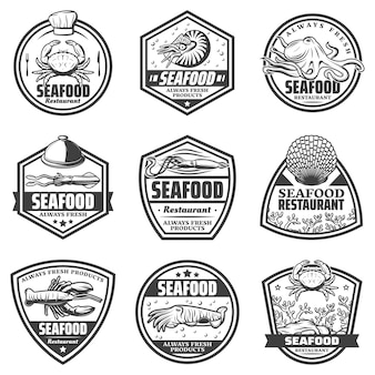 Vintage monochrome seafood labels set with crab shrimp octopus squid cuttlefish seashells lobster isolated