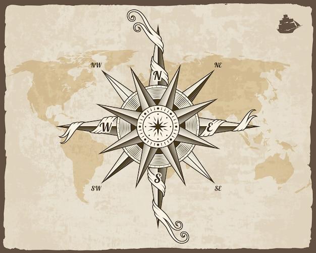 ビンテージ航海コンパス。グランジの枠を持つ紙のテクスチャの古い世界地図。風配図