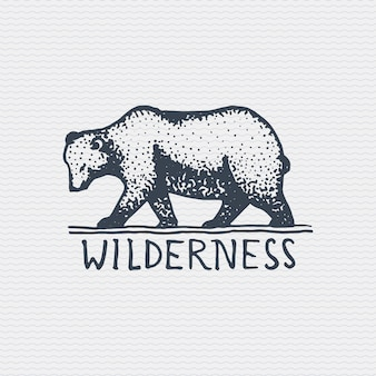 Vintage old logo or badge, label engraved and old hand drawn style with wild grizzly bear