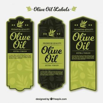 Урожай оливковые этикетки нефти в зеленых тонах