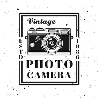 Vintage photo camera vector emblem, label, badge or logo in monochrome style isolated on background with removable grunge texture