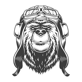 分離されたモノクロスタイルのベクトル図のヘルメットでビンテージパイロットクマの頭