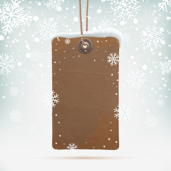 Vintage price tag on winter background wit snow and snowflakes