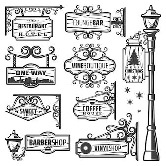 Vintage street lanterns labels set with metal pole inscriptions on wooden signboards and planks