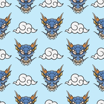 Vintage style japanese dragon head and sky tattoo seamless pattern on blue background