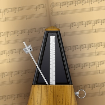 Vintage swinging metronome on page of music notebook  realistic