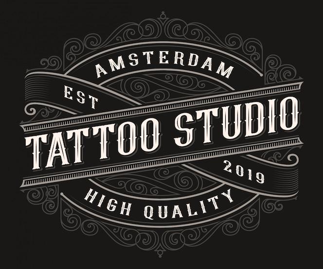 어두운 배경에 빈티지 문신 로고 디자인.