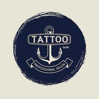 Vintage tattoo salon emblem with anchor