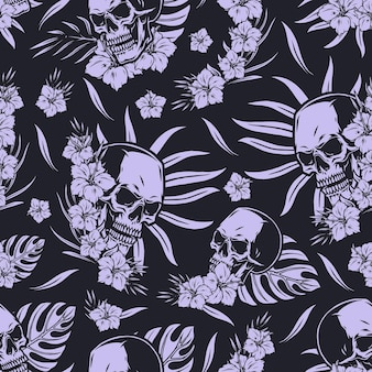 Vintage tropical seamless pattern in monochrome style with skulls exotic flowers and leaves