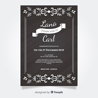 Vintage wedding invitation on blackboard