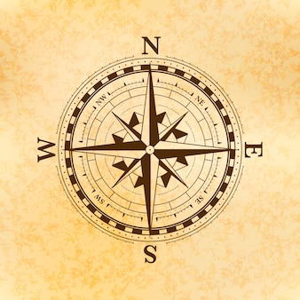 Vintage wind rose symbol, ancient compass icon on old yellow paper